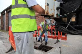 Working for blocked drain Cheltenham